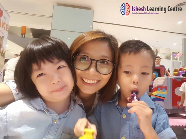 Ms. Sia with Ming zhun (right) and Daughter (left)